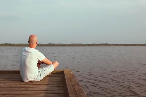 Peaceful man looking at water